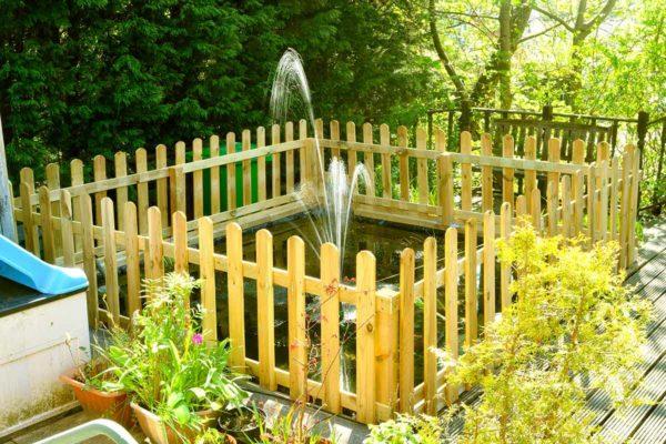 fencing surrounding garden fish pond